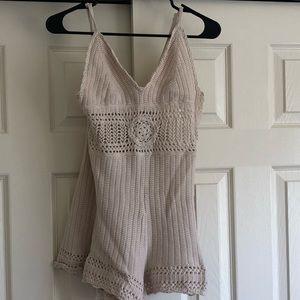 Cream colored knit romper
